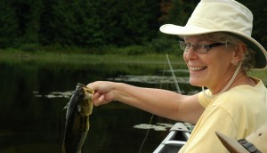 Lois with her first bass on the fly