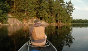 Me casting for bass from a canoe on a Muskoka lake