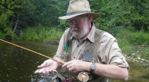Rob holds a rainbow caught on his Sweetgrass bamboo rod