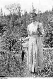 Photo taken by Tom Thomson of a woman misidentified as Winnie Trainor holding a bamboo fly rod