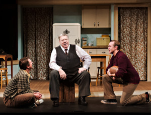 Jeffrey Wetsch as Happy, George Wendt as Willy and Skye Brandon as Biff in Death of a Salesman. Creative: Marti Maraden, Director; Allan Wilbee, Set Designer; Kimberly Catton, Costume Designer; Kevin Fraser, Lighting Designer. Photographer: Hilary Gauld Camilleri.